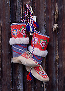Embroidered mukluks in Jan Wotton's collection on display at Carcross Barracks and made around 1950 by a Cree Nation woman for Constable Kautz of the RCMP at Peace River, Alberta.  Carcross, Yukon Territory, Canada.