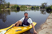 Kayaker George Wolfe of the LaLa Times. FoLAR' (Friends of the LA River) annual river cleanup, La Gran Limpieza, was held  May 9, 2009. Thousands of volunteers at 14 sites pulled out accumlated trash, mostly plastic bags, from river runoff that might normally find it's way downstream into the Pacific Ocean.