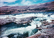 CS00305-14. Indians fishing at Celilo Falls. On the left is Chiefs island, on the right Standing island. Late 1940s.