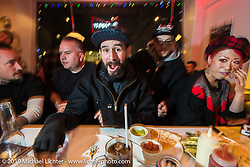 In the cafe during the Mooneyes shop and Japan HQ party after the annual Mooneyes Hot Rod and Custom Show. Japan. Monday, December 8, 2014. Photograph ©2014 Michael Lichter.