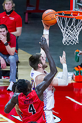 NORMAL, IL - February 27: Abdou Ndiaye attempts to block a shot by Austin Phyfe during a college basketball game between the ISU Redbirds and the Northern Iowa Panthers on February 27 2021 at Redbird Arena in Normal, IL. (Photo by Alan Look)