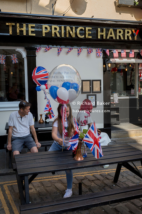 Flags and balloons outside the Prince Harry pub in the old town of Windsor as it gets ready for the royal wedding between Prince Harry and his American fiance Meghan Markle, on 14th May 2018, in London, England. (Photo by Richard Baker / In Pictures via Getty Images)