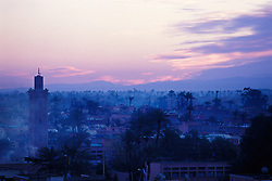 Minaret and rooftops at dawn, Marrakech, Morocco.