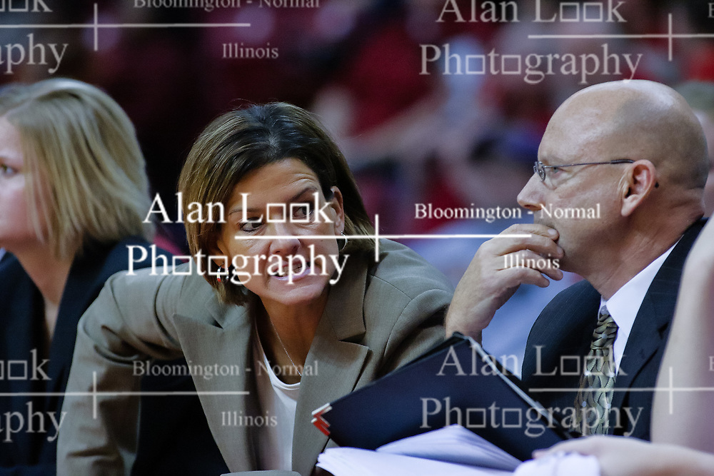04 December 2009: Robin Pingeton looks past assistant Randy Norton calling to a player on her bench. The Huskies of Northern Illinois University fall to the Redbirds of Illinois State University by a score of 85-57 on Doug Collins Court in Redbird Arena in Normal Illinois.