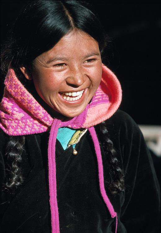 A Ladakhi girl laughs with a friend in Leh, Ladakh, India.