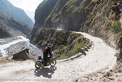 Jason Adamski riding a Royal Enfield Himalayan in Motorcycle Sherpa's Ride to the Heavens motorcycle adventure in the Himalayas of Nepal. On the fifth day of riding, we went from Muktinath to Tatopani. Friday, November 8, 2019. Photography ©2019 Michael Lichter.
