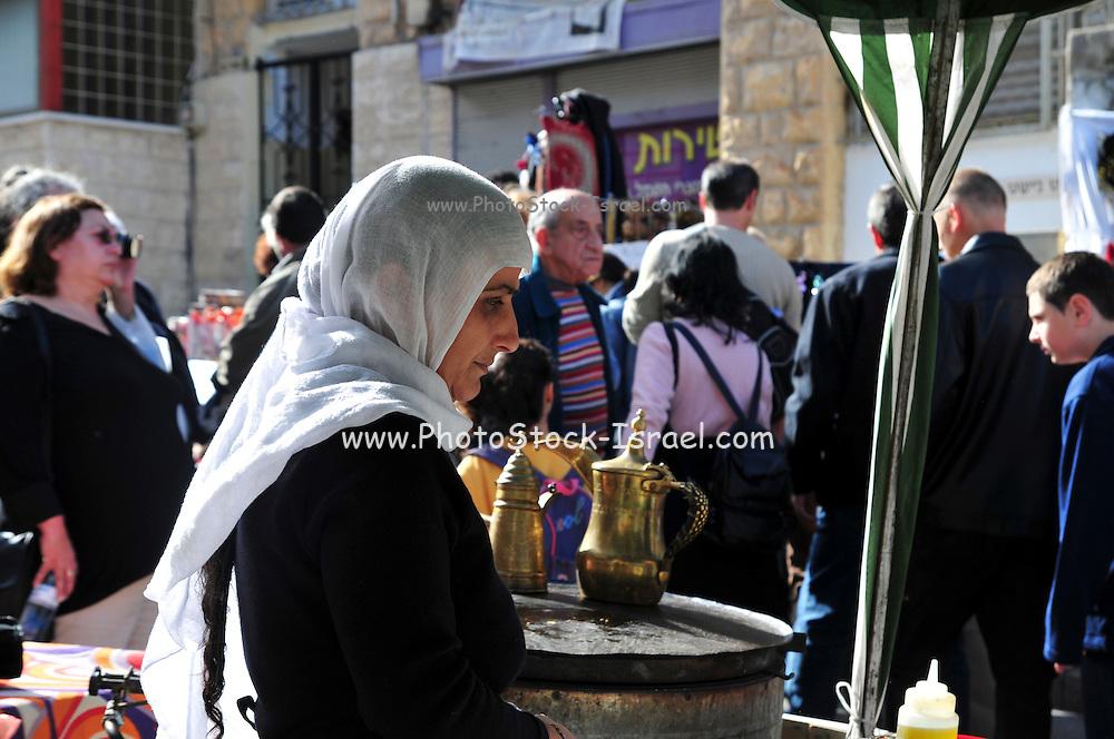 Israel, Haifa, Wadi Nisnas, the Holiday of holidays festival, celebrating Hanuka-Christmas-Ramadan December 2009. Druse food stall