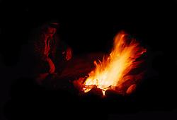 Cowboy sitting at the campfire