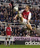 Photo. Jed Wee<br />Newcastle United v Arsenal, FA Barclaycard Premiership, St. James' Park, Newcastle. 09/02/2003.<br />Arsenal's Dennis Bergkamp acrobatically controls the ball in the Newcastle penalty area.