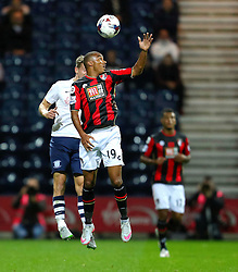 Junior Stanislas of Bournemouth wins a header- Mandatory byline: Matt McNulty/JMP - 07966386802 - 22/09/2015 - FOOTBALL - Deepdale Stadium -Preston,England - Preston North End v Bournemouth - Capital One Cup - Third Round