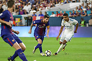 Barcelona Lionel Messi battles with Real Madrid Midfielder Casemiro during the International Champions Cup match between Real Madrid and FC Barcelona at the Hard Rock Stadium, Miami on 29 July 2017.