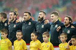 LILLE, FRANCE - Friday, July 1, 2016: Wales players sing the national anthem ahead of the the UEFA Euro 2016 Championship Quarter-Final match against Belgium at the Stade Pierre Mauroy. Gareth Bale, Hal Robson-Kanu, Joe Ledley, Ben Davies, Joe Allen. (Pic by Paul Greenwood/Propaganda)
