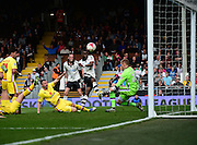 Fulham Forward Moussa Dembélé (25) shoots during the Sky Bet Championship match between Fulham and Milton Keynes Dons at Craven Cottage, London, England on 2 April 2016. Photo by Jon Bromley.
