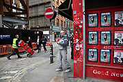 Red elements in a street scene of the exterior of a newsagents shop on Berwick Street displaying covers of Dazed and AnOther magazine on 18th February 2020 in London, England, United Kingdom. Part of Soho's ex-red light district, Berwick Street is one of central London's most varied thoroughfares full of small independent shops.