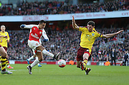 Alexis Sanchez of Arsenal takes a shot for goal as Matthew Lowton of Burnley attempts to block. The Emirates FA cup, 4th round match, Arsenal v Burnley at the Emirates Stadium in London on Saturday 30th January 2016.<br /> pic by John Patrick Fletcher, Andrew Orchard sports photography.