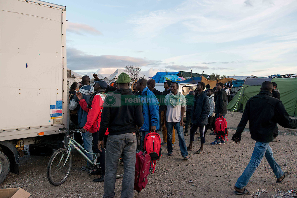 October 22, 2016 - Calais, France - Distrbution of luggages inside of the camp in Calais, France on 22 October 2016. As the date of the eviction gets closer, the migrants and refugees of jungle are thinking about their options. Some have decided to to leave the camp before the start of the dismantling, others are willing to stay in France and therefore to follow with the plan of entering a center. (Credit Image: © Guillaume Pinon/NurPhoto via ZUMA Press)