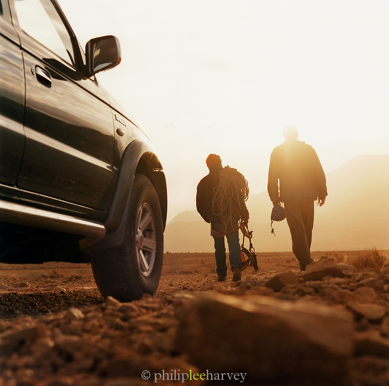 Mountaineers leave their vehicle and head towards the hills, Morocco