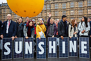 Climate campaign group 10:10 covered Old Palace Yard outside the House of Commons with dozens of solar panels held by climate activists on 5th December 2018 in Westminster, London. United Kingdom. The opening of Westminsters first solar park calling on the government to stop their plans to axe the export tariff. The tariff pays small scale solar owners for their excess energy.