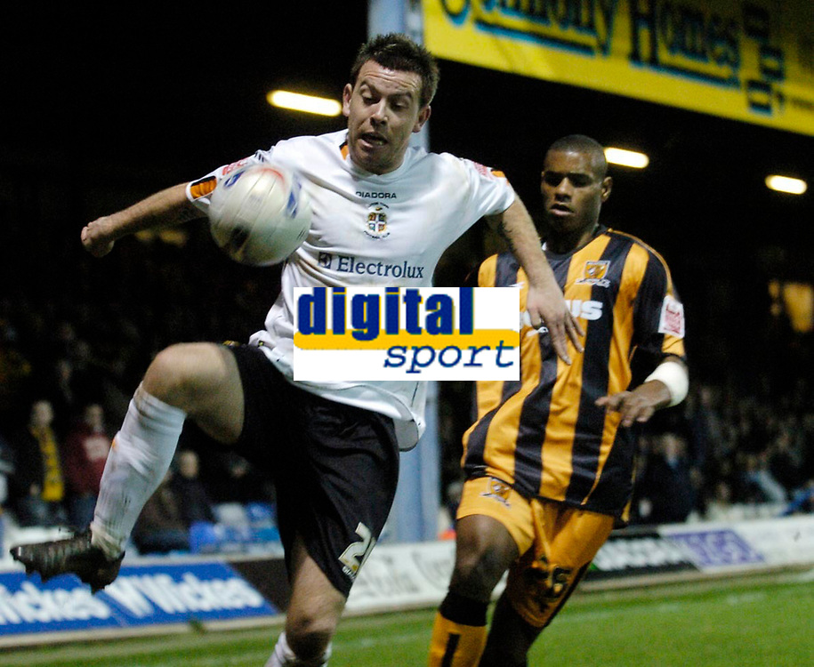 Photo: Leigh Quinnell.<br /> Luton Town v Hull City. Coca Cola Championship. 13/03/2007. Lutons Keith Keane wins the ball from Hulls Ricardo Vazte.