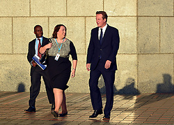 """© Licensed to London News Pictures. 21/01/14 Jessica Lee MP, has said she is stepping down from Parliament after considering her """"personal circumstances and responsibilities"""". She is the fourth female Conservative MP elected in 2010 to leave Parliament.FILE PICTURE DATED 09/10/2012. Birmingham , UK . The British Prime Minister ,  David Cameron (R) , at the conference this (9th October) morning walking with Jessica Lee MP for Erewash (L) . Day 3 of the Conservative Party Conference at the International Convention Centre in Birmingham . Photo credit : Joel Goodman/LNP"""