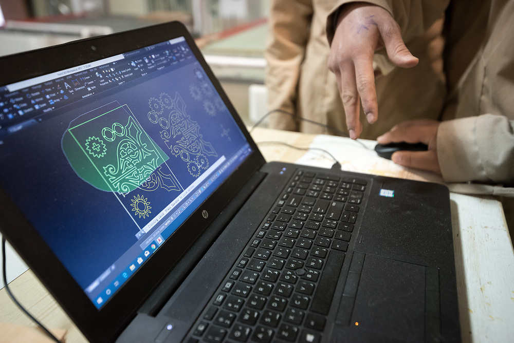 25 February 2020, Jerusalem: Students operate a CNC cutter following a computer model. The Lutheran World Federation's vocational training centre in Beit Hanina offers vocational training for Palestinian youth across a range of different professions, providing them with the tools needed to improve their chances of finding work.