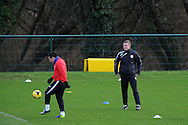 Cardiff city manager Ole Gunnar Solskjaer keeps an eye on Gary Medel . Cardiff city team training at the Vale, Hensol, near Cardiff on  Friday 10th Jan 2014.<br /> pic by Andrew Orchard, Andrew Orchard sports photography.