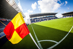 The corner flag in sunlight at The Falkirk Stadium, with the new pitch work for the Scottish Championship game v Morton. The woven GreenFields MX synthetic turf and the surface has been specifically designed for football with 50mm tufts compared with the longer 65mm which has been used for mixed football and rugby uses.  It is fully FFA two star compliant and conforms to rules laid out by the SPL and SFL.<br /> ©Michael Schofield.