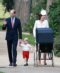 File photo dated 05/07/15 of the Duke and Duchess of Cambridge with Prince George and Princess Charlotte pushed to her christening at the Church of St Mary Magdalene in Sandringham, Norfolk. The Duchess of Cambridge will have spent a decade as an HRH when she and the Duke of Cambridge mark their 10th wedding anniversary on Thursday. Issue date: Wednesday April 28, 2021.