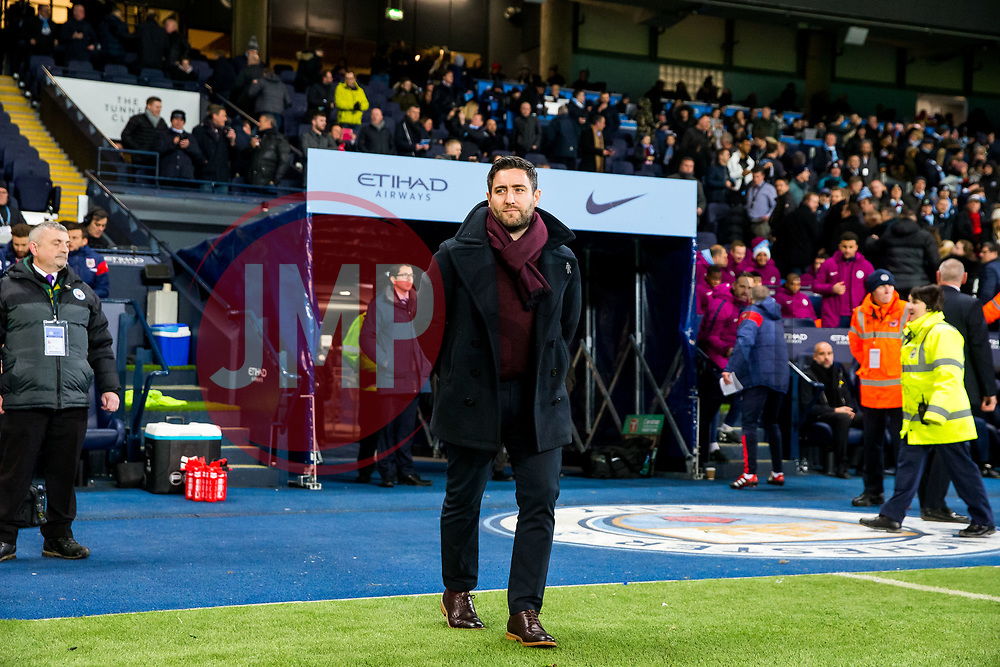 Bristol City Head Coach Lee Johnson looks on in his technical area before kick off - Rogan/JMP - 09/01/2018 - Etihad Stadium - Manchester, England - Manchester City v Bristol City - Carabao Cup Semi Final First Leg.