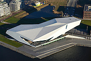 Nederland, Noord-Holland, Amsterdam, 11-12-2013; IJ met IJ-oevers en IJpromenade,  stadswijk Overhoeks. Filmmuseum Eye van architecten Roman Delugan en Elke Delugan-Meissl (DMAA). Naast het museum de (voormalige) Shell toren en nieuwbouw op het voormalige terrein van het Shell laboratorium.<br /> Water of IJ with its banks and IJpromenade, district Overhoeks. Filmmuseum Eye from architects Roman Delugan and Elke Delugan-Meissl (DMAA). Next to the museum (former) Shell tower and new developements on the former site of the Shell laboratory.<br /> luchtfoto (toeslag op standaard tarieven);<br /> aerial photo (additional fee required);<br /> copyright foto/photo Siebe Swart.