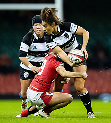 Sene Naoupu of Barbarians looks to offload despite the attentions of Keira Bevan of Wales<br /> <br /> Photographer Simon King/Replay Images<br /> <br /> Friendly - Wales v Barbarians - Saturday 30th November 2019 - Principality Stadium - Cardiff<br /> <br /> World Copyright © Replay Images . All rights reserved. info@replayimages.co.uk - http://replayimages.co.uk