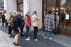 © Licensed to London News Pictures. 02/09/2021. London, UK. Customers queue up outside the H&M Regent Street store to buy items from TOGA ARCHIVES X H&M clothes collection. Designed by Yasuko Furuta, founder and designer of TOGA in collaboration with H&M, the collection. Includes women's and mens clothes. Photo credit: Ray Tang/LNP