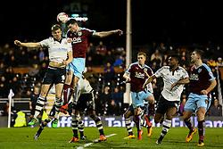 Michael Keane of Burnley heads the ball over Richard Stearman of Fulham - Mandatory by-line: Jason Brown/JMP - Mobile 07966 386802 08/03/2016 - SPORT - FOOTBALL - Fulham, Craven Cottage - Fulham v Burnley - Sky Bet Championship