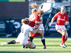 Hannah Jones of Wales is tackled by Poppy Cleall of England<br /> <br /> Photographer Simon King/Replay Images<br /> <br /> Six Nations Round 3 - Wales Women v England Women - Sunday 24th February 2019 - Cardiff Arms Park - Cardiff<br /> <br /> World Copyright © Replay Images . All rights reserved. info@replayimages.co.uk - http://replayimages.co.uk