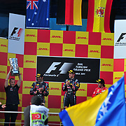 Red Bull Formula One driver Sebastian Vettel of Germany (C) celebrates with the trophy on the podium as team mate Mark Webber of Australia (L) and Ferrari Formula One driver Fernando Alonso of Spain (R) watch, after he won the Turkish F1 Grand Prix at the Istanbul Park circuit in Istanbul May 8, 2011. Photo by TURKPIX