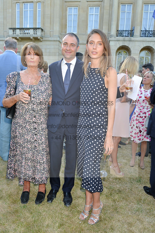 Left to right, LADY ANNABEL GOLDSMITH, her son BEN GOLDSMITH and JEMIMA GOLDSMITH at the Quintessentially Foundation and Elephant Family 's 'Travels to My Elephant' Royal Rickshaw Auction presented by Selfridges and hosted by HRH The Prince of Wales and The Duchess of Cornwall held at Lancaster House, Cleveland Row, St.James's, London on 30th June 2015.