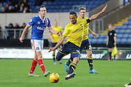 Oxford United midfielder Kemar Roofe shoots during the Sky Bet League 2 match between Oxford United and Carlisle United at the Kassam Stadium, Oxford, England on 12 December 2015. Photo by Alan Franklin.