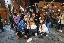 © Licensed to London News Pictures. 17/04/2021. Liverpool, UK. Revellers from Belfast pose for a photograph as they enjoy the first weekend in Liverpool city centre after lockdown restrictions were eased Photo credit:  Ioannis Alexopoulos/LNP
