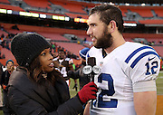 Indianapolis Colts quarterback Andrew Luck (12) talks to FOX Sports sideline reporter Pam Oliver after the NFL week 14 regular season football game against the Cleveland Browns on Sunday, Dec. 7, 2014 in Cleveland. The Colts won the game 25-24. ©Paul Anthony Spinelli
