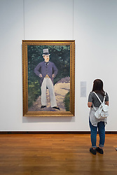 Woman looking at painting Portrait of Monsieur Brun by Edouard Manet at National Museum of  Modern Art  in Tokyo  Japan