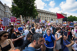 London, June 17th 2017. Protesters demonstrate against the Conservative's intended alliance with the Democratic Unionist Party (DUP) in Whitehall, London. The proposed pact will enable the Tories to maintain a small level of dominance in the House of commons after their majority was wiped out in the June 8th general election.