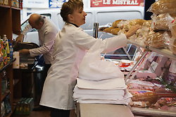 Shop Assistant serving customer in Polish Delicatessen,