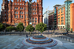 © Licensed to London News Pictures . 13/08/2019. Manchester, UK. A permanent memorial on the site of The Peterloo Massacre ( formerly St Peter's Field , now the Manchester Central Convention Centre ) , designed by artist Jeremy Deller , is opened to the public for the first time this evening (Tuesday 13th August 2019) . The tribute follows a long campaign to see the event memorialised and comes ahead of the massacre's 200th anniversary . The stepped design has been criticised by some for failing to consider accessibility for disabled people . On 16th August 1819 , a rally calling for Parliamentary reform , improved workers rights and against poverty was brutally suppressed by sabre-wielding cavalrymen , resulting in the deaths of fifteen people and many hundreds injured . Photo credit: Joel Goodman/LNP