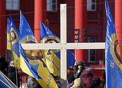 November 18, 2018 - Kiev, Ukraine - Cross and Ukrainian flags with image of Jesus Christ are seen during a protest of activists against a rally to support of transgender people in Kiev, Ukraine, on 18 November 2018. The activists protest against another a rally of activists who held a rally to support transgender people prior the Transgender Day of Remembrance, an annual marked on 20 November. (Credit Image: © Serg Glovny/ZUMA Wire)