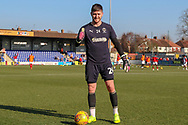 AFC Wimbledon goalkeeper Joe McDonnell (24) warming upduring the EFL Sky Bet League 1 match between AFC Wimbledon and Charlton Athletic at the Cherry Red Records Stadium, Kingston, England on 23 February 2019.