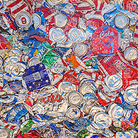 062613       Cable Hoover<br /> <br /> Hundreds of aluminum cans are compressed into a 400-pound block at All City Recycling in Gallup Wednesday so that they can be shipped to a larger recycling facility.
