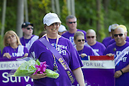 Pine Bush, New York - The grand marshal of the survivors' walk smiles during the Pine Bush  Relay for Life on Saturday, June 7, 2014. The Relay for Life is the American Cancer Society's largest fundraising event. ©Tom Bushey / The Image Works