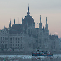 Ice breaker ship crushes floating ice on river Danube in front of the Hungarian Parliament building in Budapest, Hungary on January 11, 2017. ATTILA VOLGYI