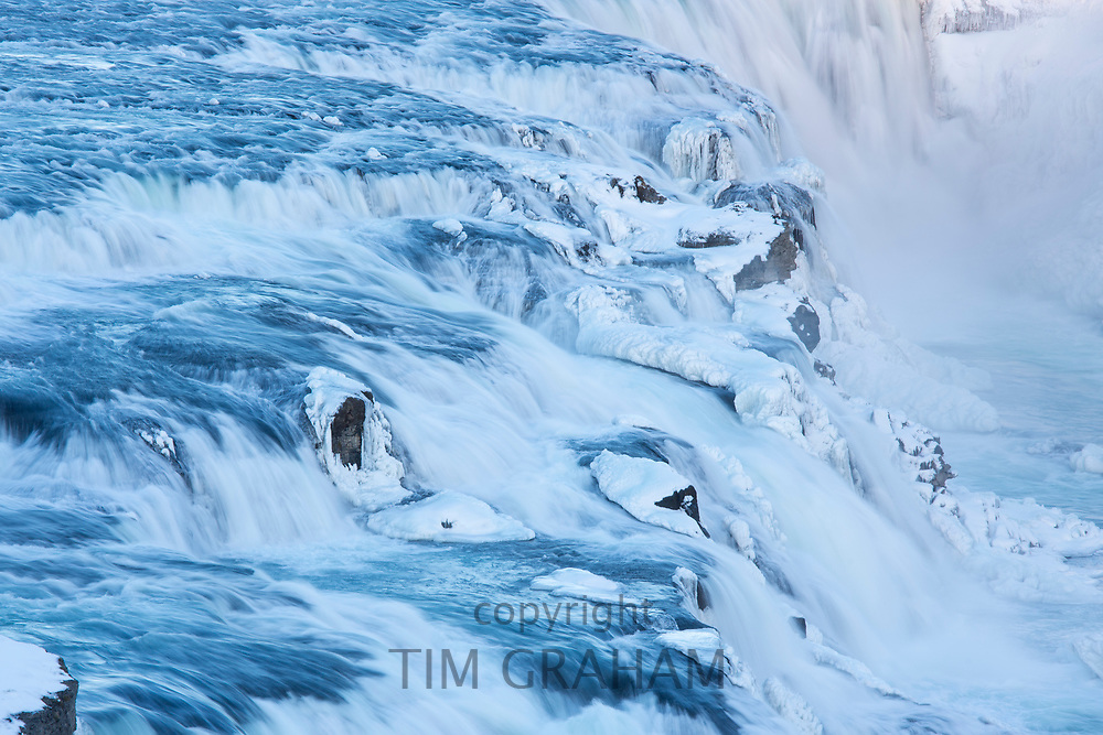 Gushing, flowing water glacial river at thundering falls of Gullfoss Waterfall in South Iceland