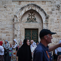 Outside the Holy Church of the Sepulchre, pilgrims gather before entering